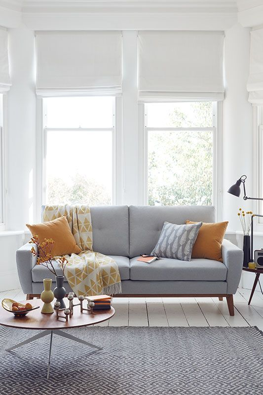 5 fun ways to customise a plain blind using pom poms for Yellow sofa living room ideas